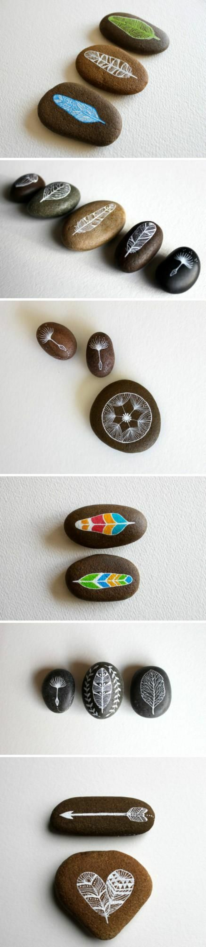 galets-peints-motifs-amerindiens-plumes-et-feuilles-fleches-et-fleurs-idee-d-activité-créative