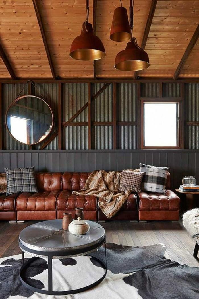 hangar-amenage-canape-en-cuir-miroir-rond-table-rond-tapis-table-de-chevet