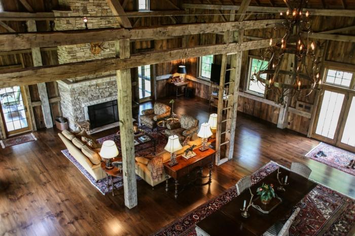 hangar-amenage-cheminee-en-pierre-air-rustique-echelle-decorative-tapis-ethnique