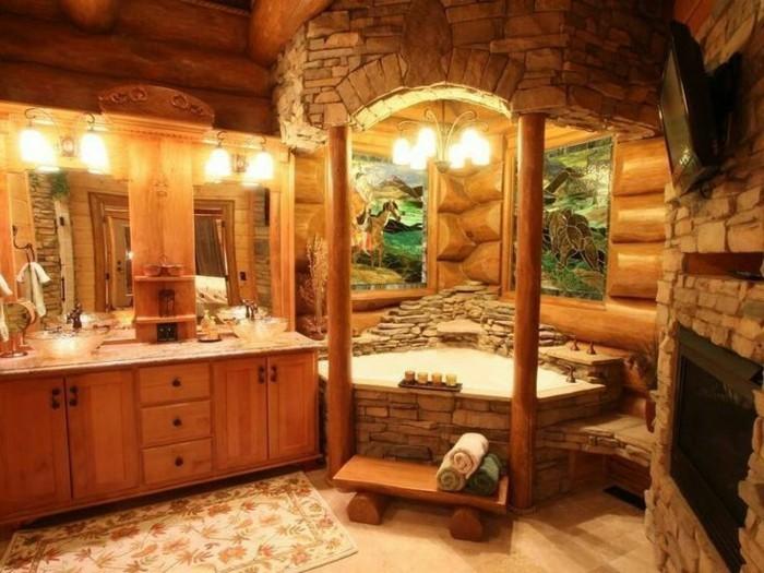 hangar-amenage-salle-de-bain-en-bois-et-pierre-grand-miroir-tapis-serviettes-propres