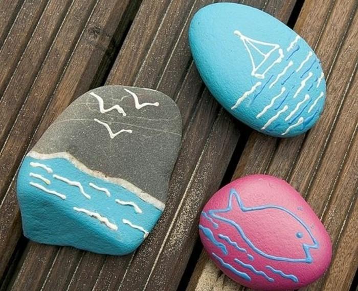 peinture-theme-bord-de-mer-réalisée-sur-des-galets-décoratifs-exemple-d-activite-ludique-enfant