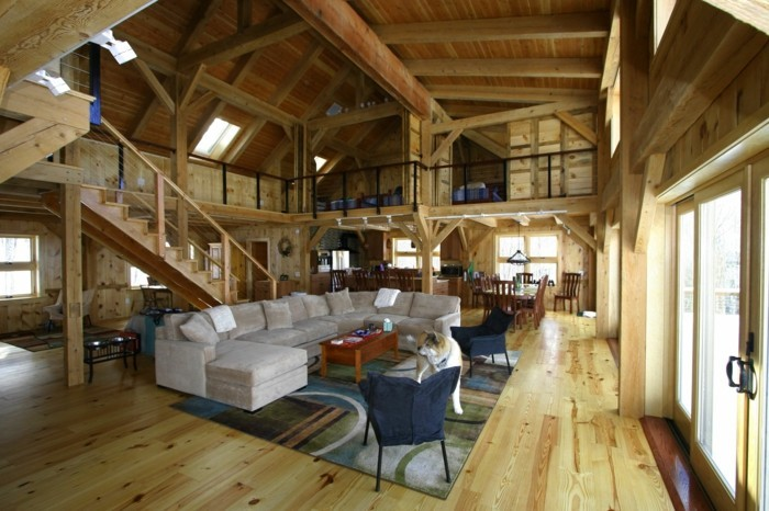 renovation-ferme-tapis-en-bleu-et-vert-canape-blanc-hangar-transforme-ambiance-accueillante