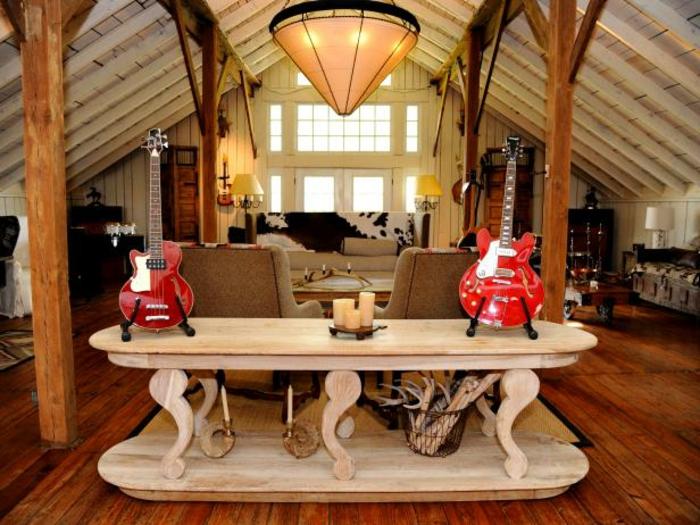 renovation-grange-guitares-rouges-electriques-ambiance-musicale-colonnes-en-bois