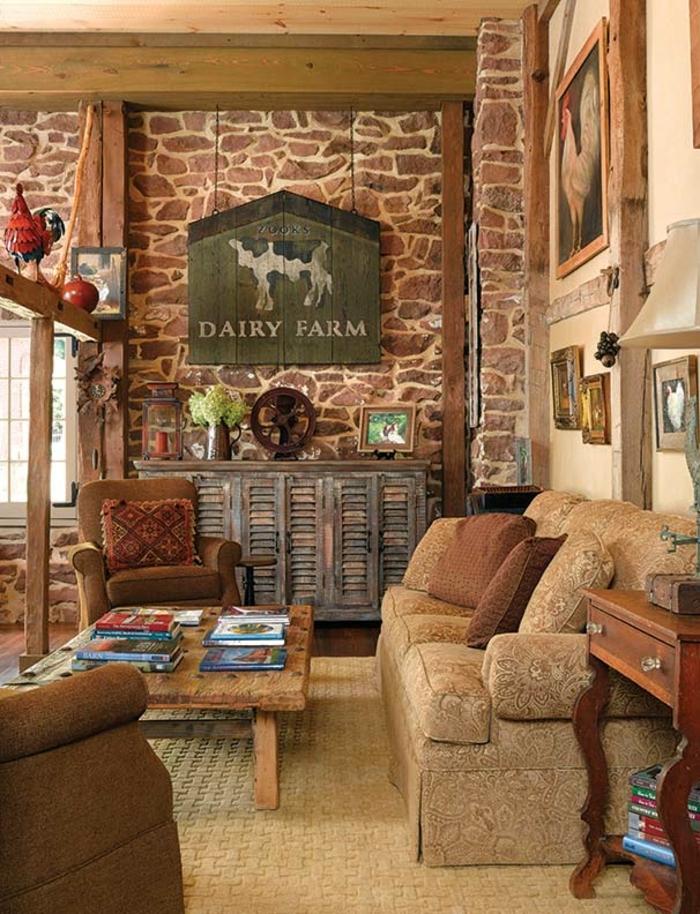 renovation-grange-salon-ideal-rustique-fauteuil-et-canape-confortables-en-beige-coussins-peintures-photos