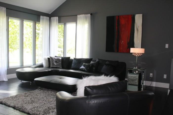 salon-gris-et-noir-canapé-en-cuir-et-tapis-gris-grand-tableau-en-trois-couleurs