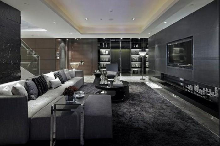 salon-gris-et-noir-spacieux-tapis-moelleux-table-ronde-basse