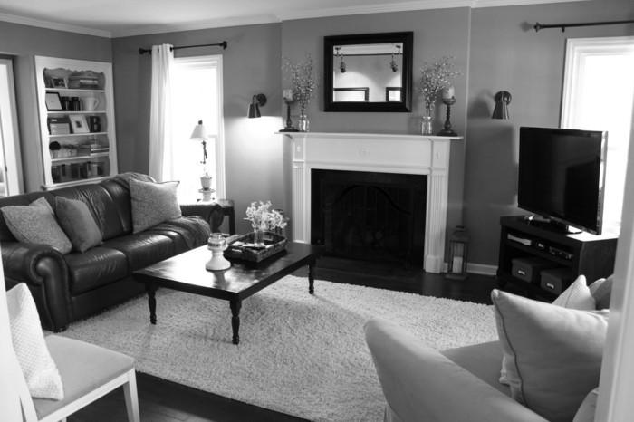 salon-noir-et-gris-sofa-cuir-cheminée-décorative-blanche