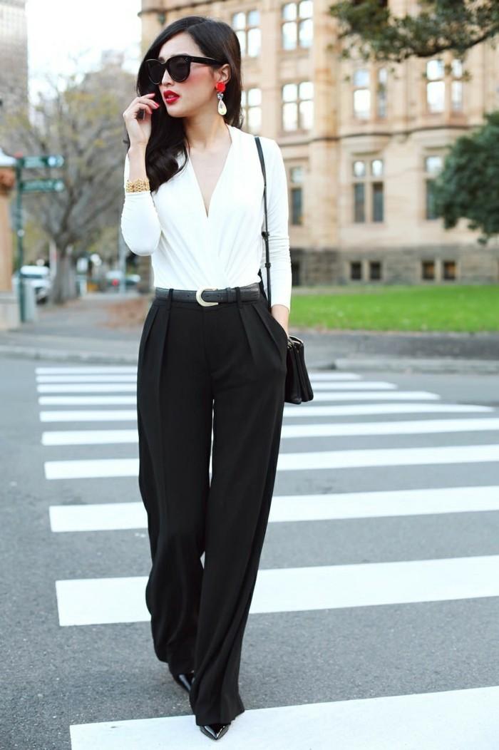 tenue-professionnelle-femme-pantalon-classique-en-noir-avec-une-ceinture-boucles-d'oreilles