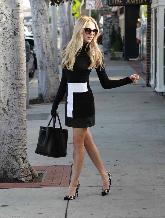 tenue-professionnelle-femme-robe-noire-avec-décoration-blanche-accessoires-en-cuir