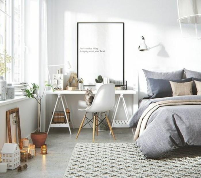 une-chambre-a-coucher-scandinave-lit-avec-des-couvertures-grises-tapis-gris-clair-bureau-blanc-et-chaise-scandinave-decoration-scandinave-avec-de-multiples-details-deco