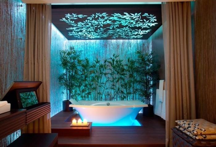 salle-de-bain-turquoise-lumière-mur-végétale-bougies-baignoire-meuble-en-bois