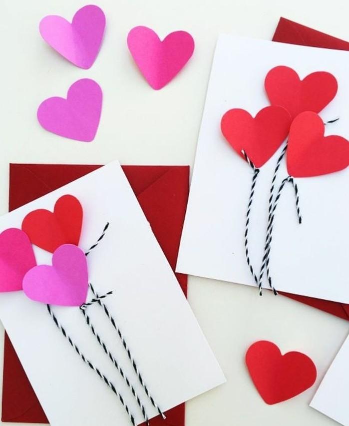 des coeurs rose et rouges sur un bout de feuille blanc, activité créative matenrelle à réaliser pour la Saint Valentin