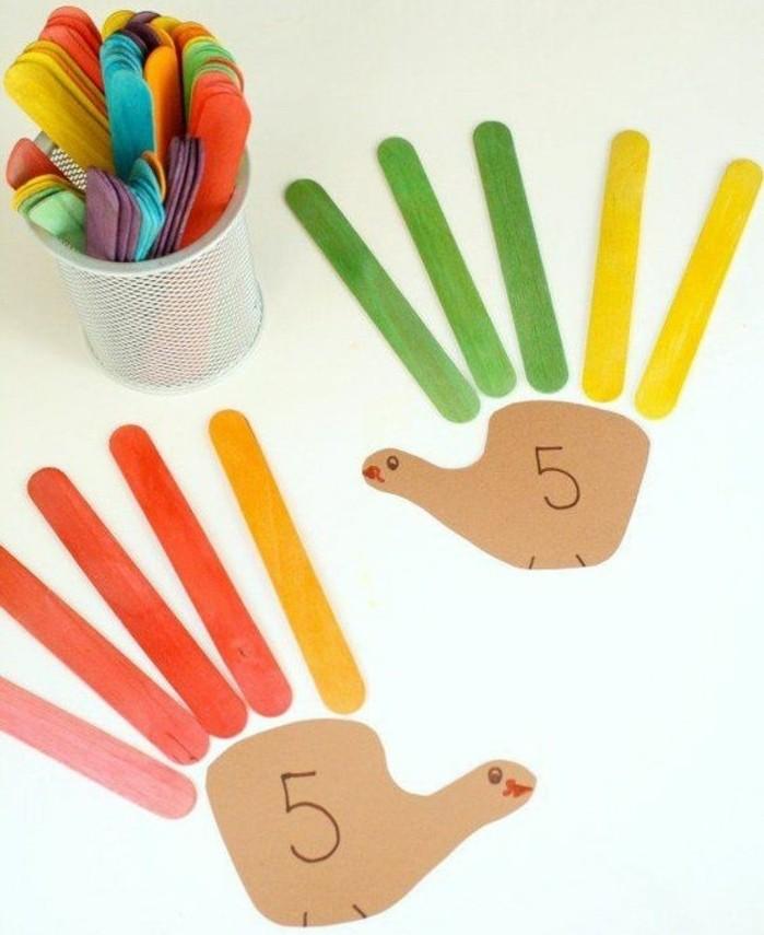 des mains réalisés à l'aide de batonents de glace repeints en couleurs diverses et papier, idée activité manuelle maternelle