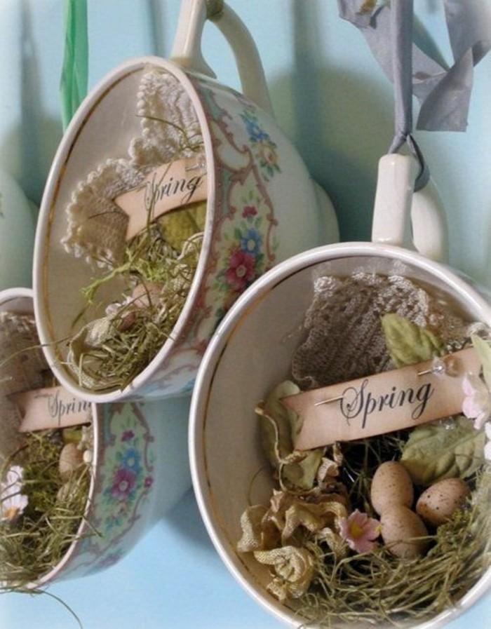 activité-manuelle-paques-un-nid-d-oiseau-dans-une-tasse-à-thé-motifs-fleurs-idée-comment-décorer-son-intérieur-pour-le-printemps