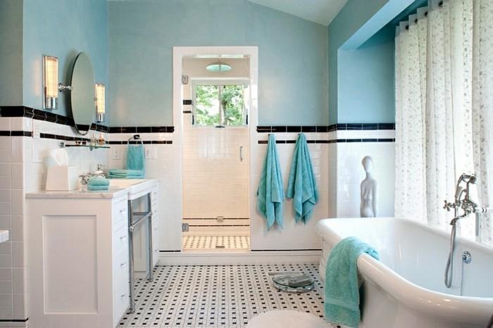 carrelage-blanc-et-noir-murs-serviettes-turquoise-baignoire-miroir-rond-lampes