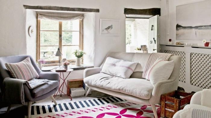 idee deco salon cocooning, canapé blanc, fauteuil gris, coussins décoratifs, paysage blanc et noir