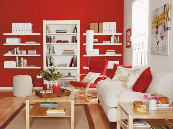 salon feng shui, murs rouges, étagères blanches, chaise à basculer, canapé blanc