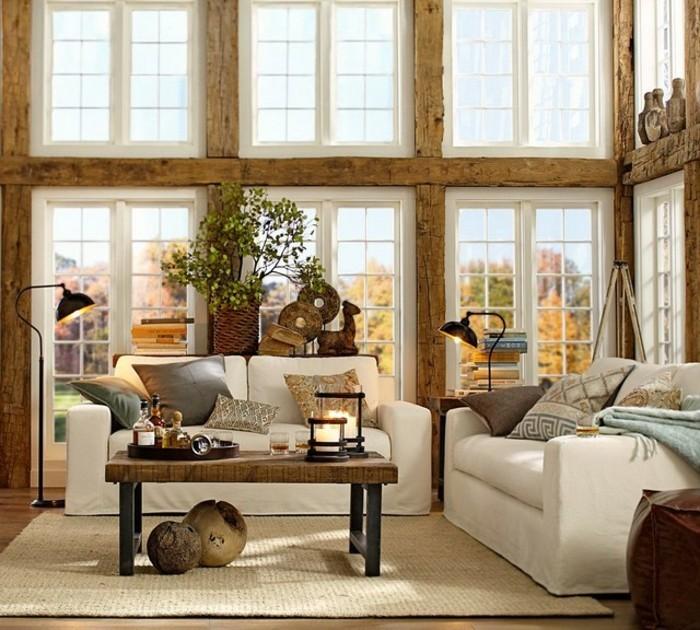 salon feng shui, tapis beige, grandes fenêtres, plantes vertes, bougies allumées