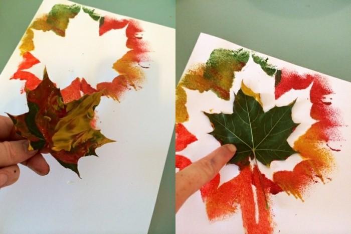 feuilles recouvertes de peinture et impreintes sur du papier, idée activité manuelle maternelle à faire soi meme