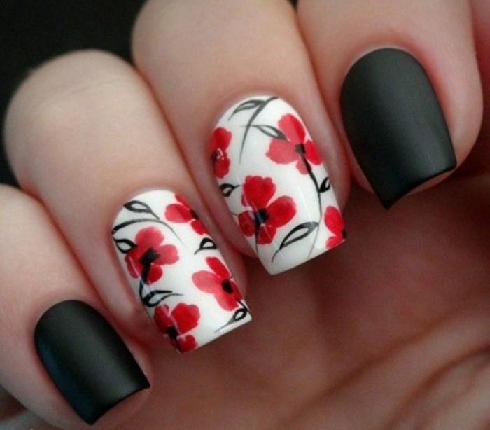 dessin-sur-ongle-dessins-fleurs-rouges-ongles-blancs-et-noires