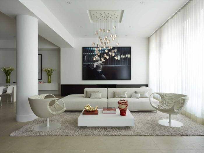 decoration zen, murs blancs, fleurs vertes, canapé blanc, grande fenêtre, objets rouges