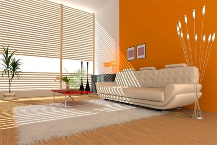 déco zen, tapis en fausse fourrure, plantes tropicales, canapé beige, stores, mur orange