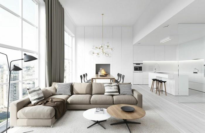 feng shui salon, rideaux longs gris, canapé taupe, table basse ronde, grandes fenêtres