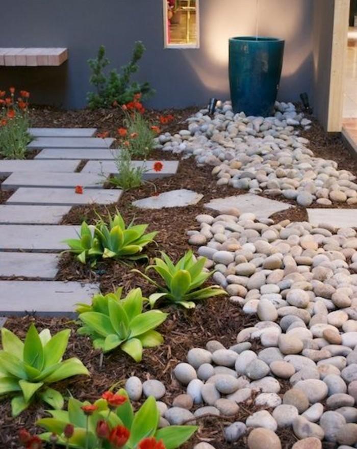 galets-terreau-et-fleurs-petit-sentier-décoré-de-plaques-en-béton-idée-comment-faire-une-rocaille-soi-meme
