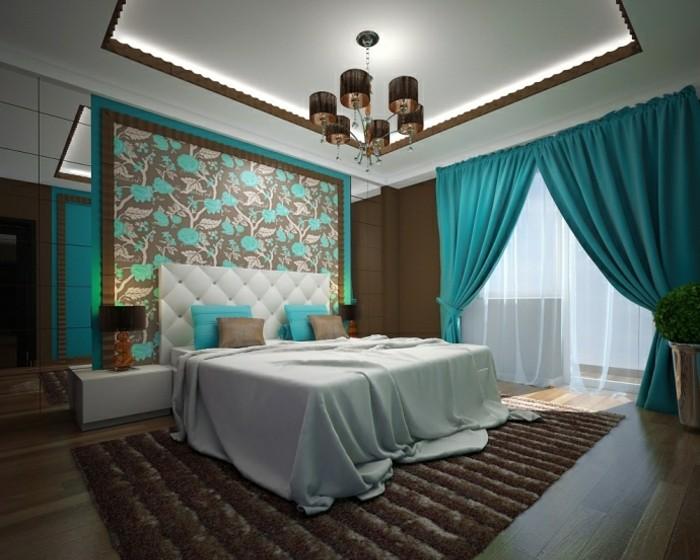 chambre adulte bleu et marron, plafond suspendu, tapis en fausse fourrure