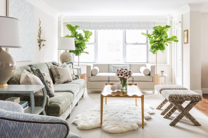amenagement salon, tapis en fausse fourrure, plantes vertes, canapé kaki, grandes fenêtres