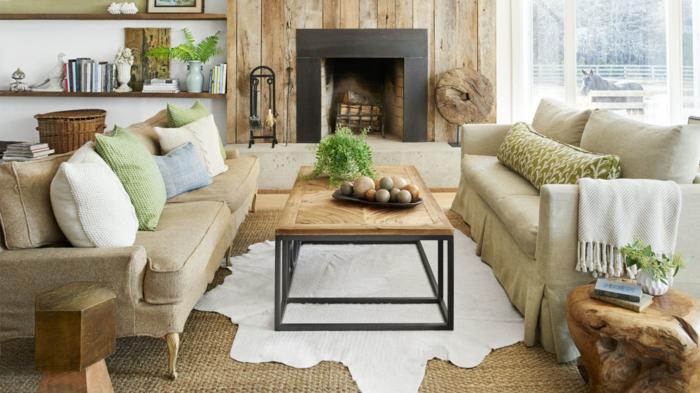 salon cocooning, canapé beige, plaid à frange, coussins décoratifs, panier en paille, table en bois