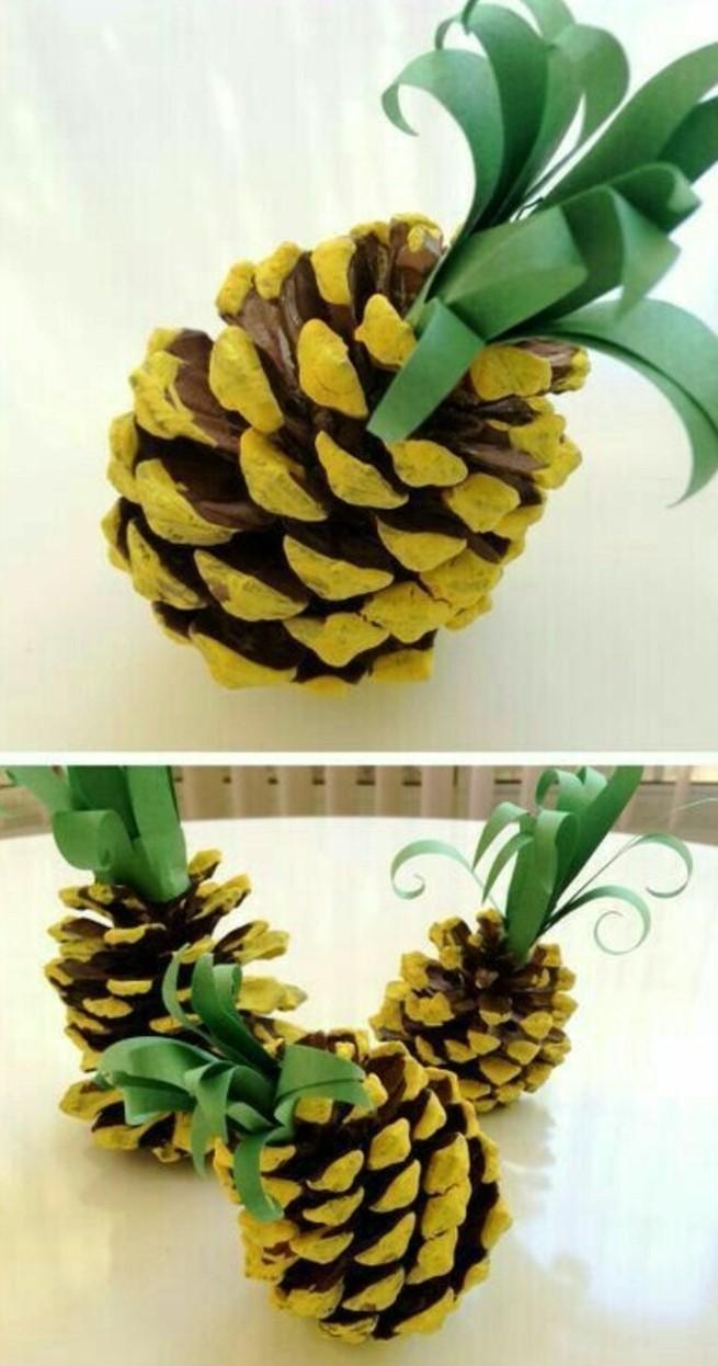 un ananas, une pomme de pin peinte en jaune, avec des feuilles vertes, idée activité créative de printemps maternelle