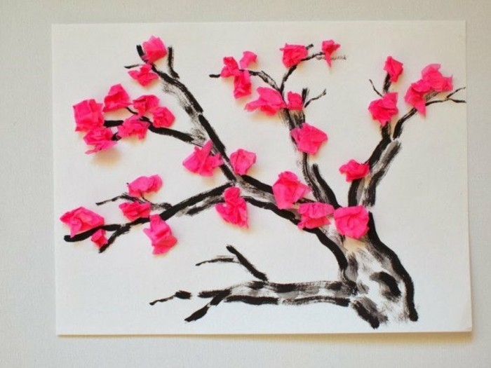 une-peinture-branche-d-arbre-marron-décorée-de-fleurs-rose-en-crépon-exemple-d-activité-manuelle-primaire-diy
