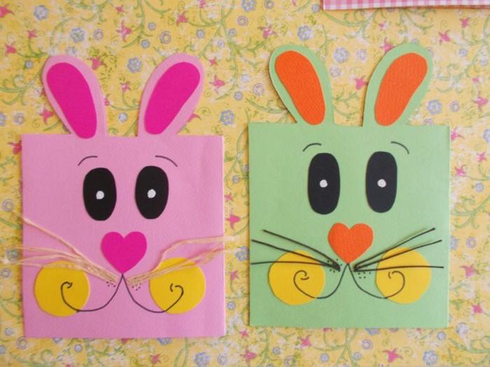 carte de paques, motif lapin de paques rose et vert, traits de visage en papier, museau coeur, des yeux noirs, moustaches