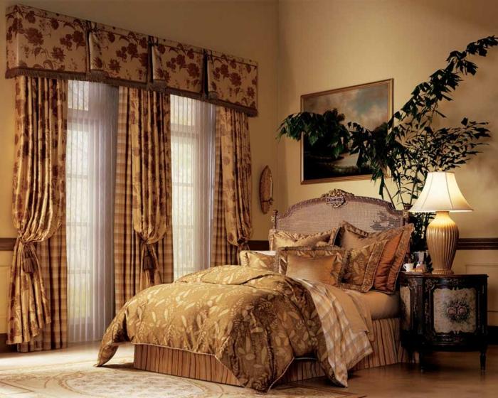 le nid douillet, rideaux longs, tapis beige, lampe de chevet, plante verte, peinture murale