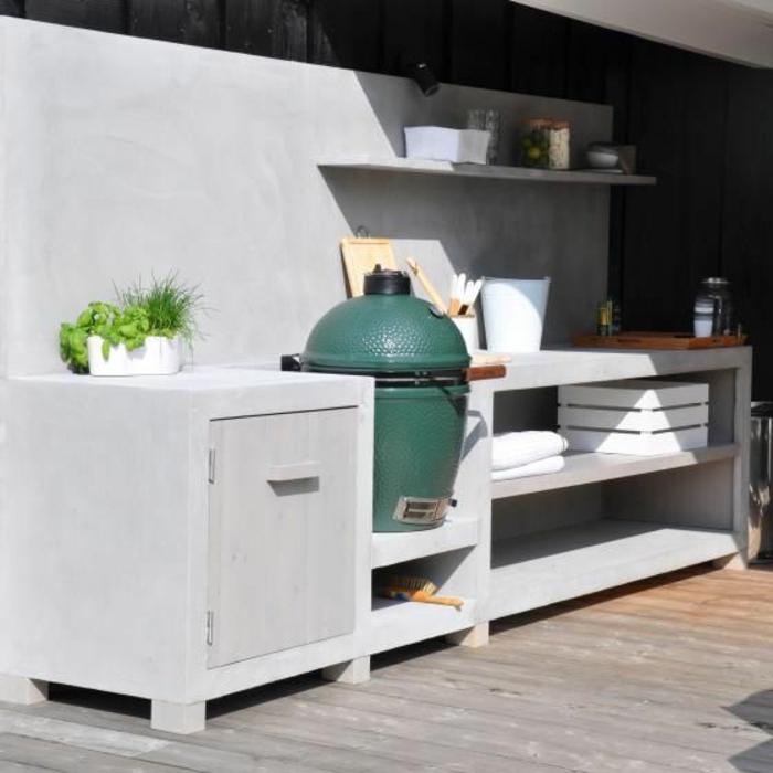 construction robuste en béton, cuisine d'été à barbecue au design épuré