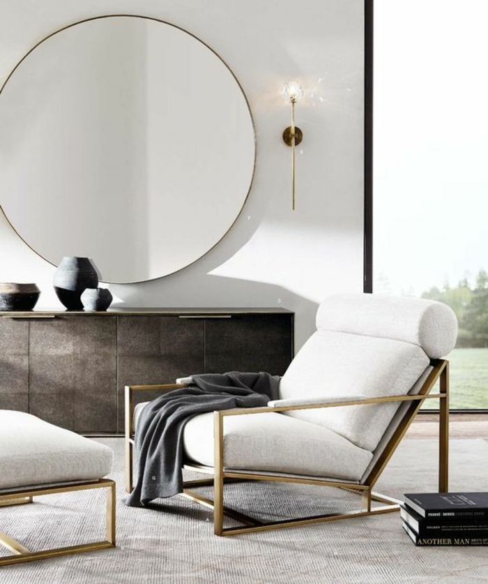 déco minimaliste, grande chaise confortable, commode moderne, grand miroir rond