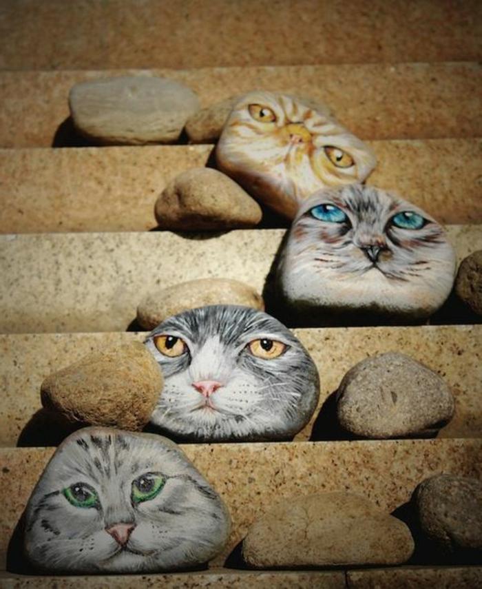 dessin sur galet, galets décorés avec chat trompe l'oeil