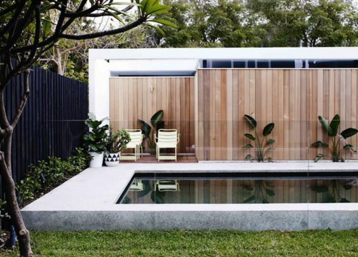 bassin de nage moderne aux lignes épurées, contour piscine en béton