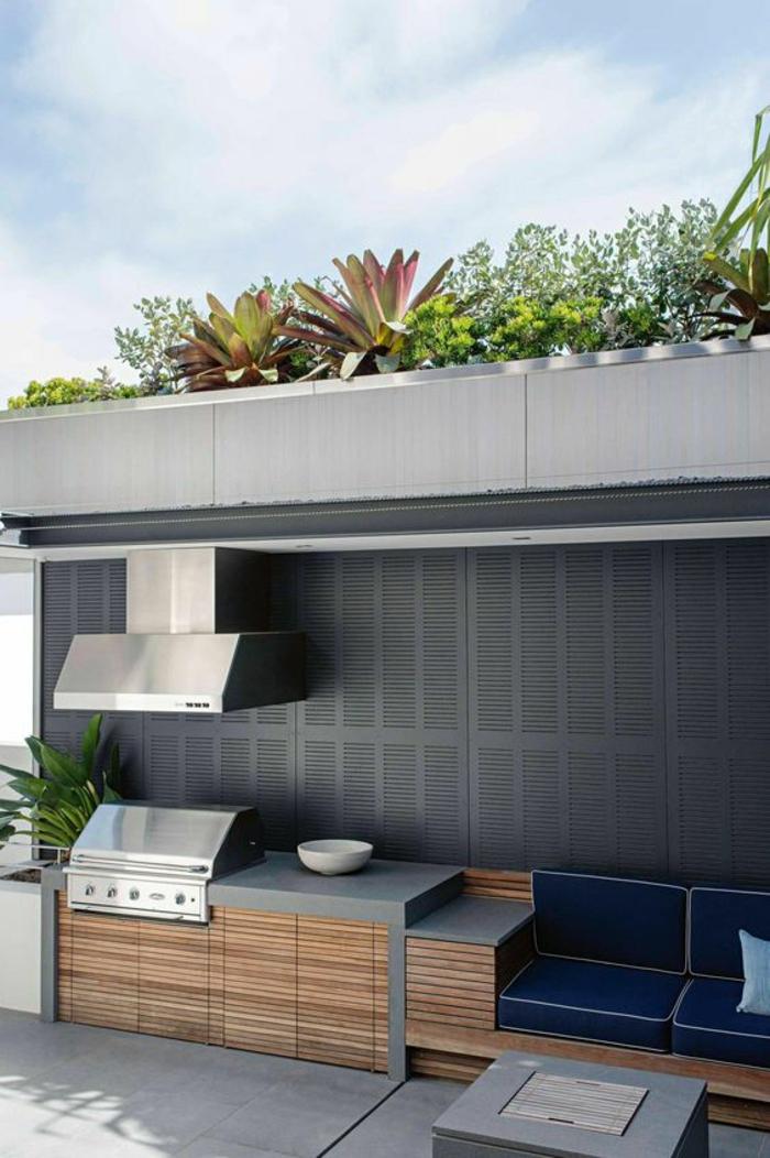 cuisine d'été au design contemporain en béton et bois avec barbecue