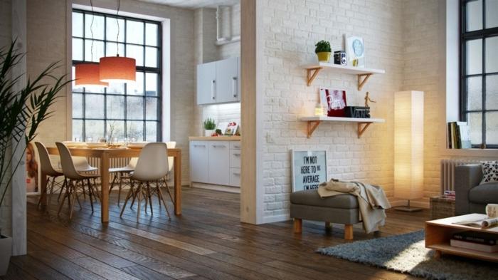 idée home staging, grande fenêtre noire en carreaux, table de salle à manger, lampes suspendues orange