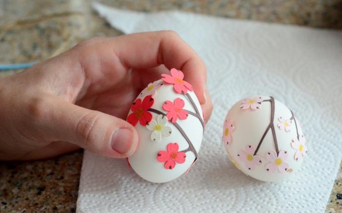 idée activité manuelle paques, des coquilles d oeufs décorées avec des fleurs en papier, idée de coquille oeuf deco paques