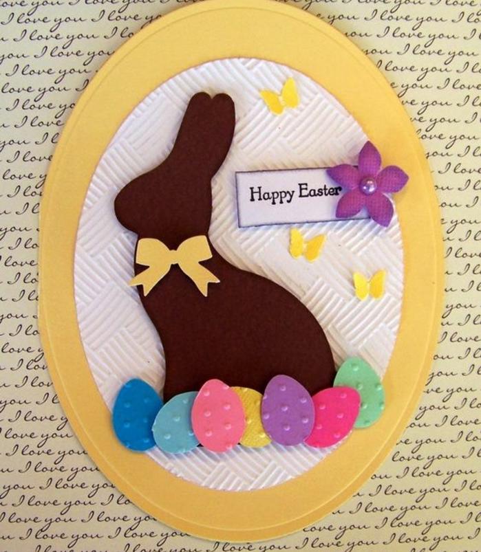 carte de paques en forme d oeuf coloré jaune, silhouette lapin de paques, oeufs colorés, papillons, fleur, ruban jaune,