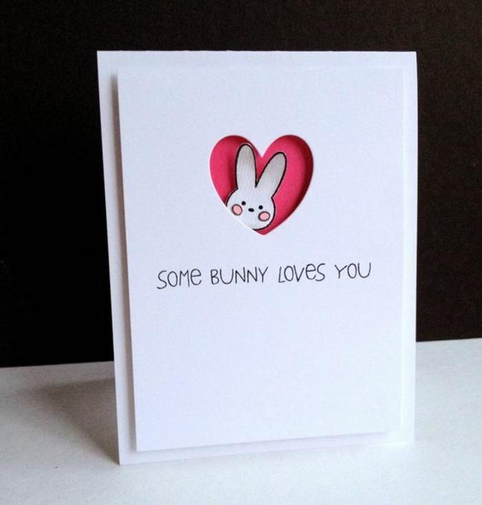 carte joyeuses paques très simple, fond carte blanche, Fenêtre coeur rose, lapin de paques blanc, message marrant