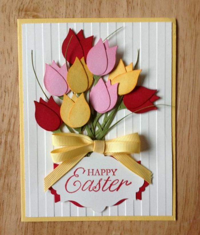 idée activité créative de paques, des tulipes en papier rose, jaune et rouge, tuges en papier vert, ruban jaune, carte joyeuse paques