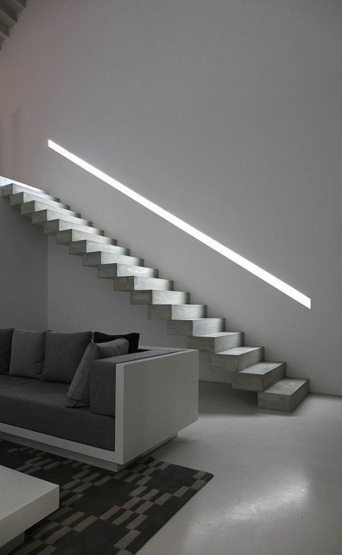 intérieur minimaliste, escalier droit sans parois, sofa blanc avec coussins gris