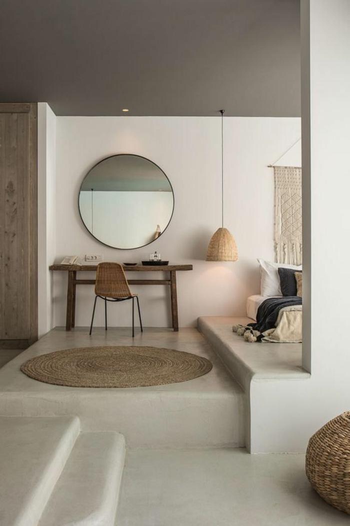 intérieur minimaliste, console en bois, miroir rond, tapis sisal rons, bureau