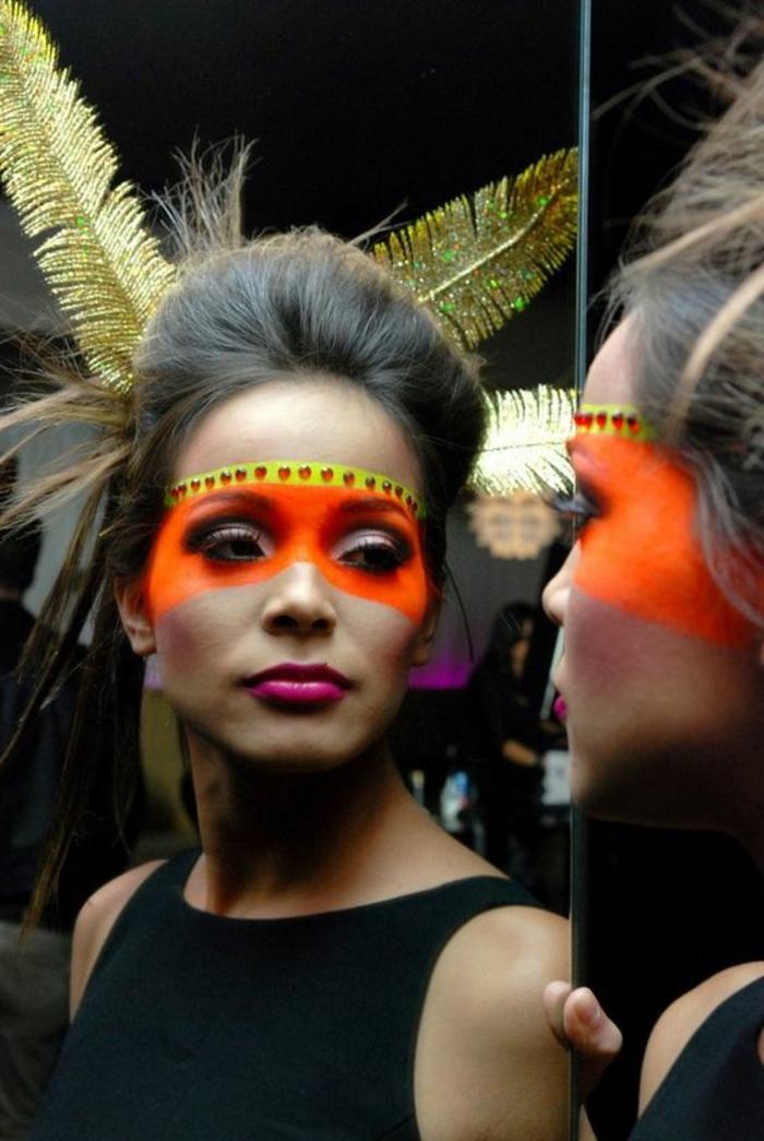maquillage indien femme, face painting sur un visage féminin et plumes dorés