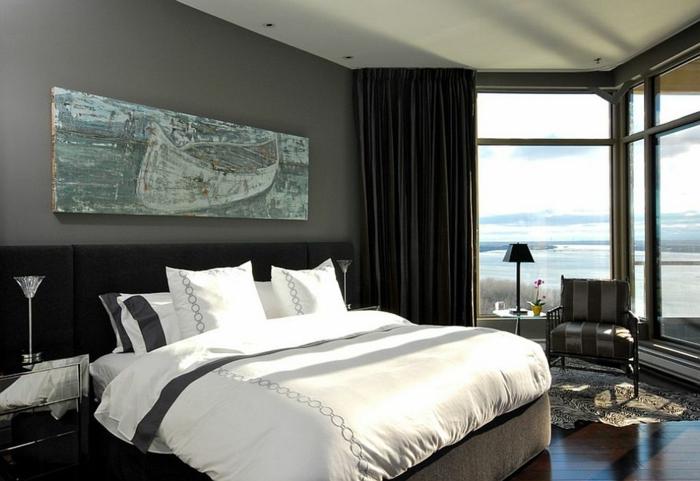 le nid douillet, tête de lit noire, grande fenêtre, couverture de lit blanche