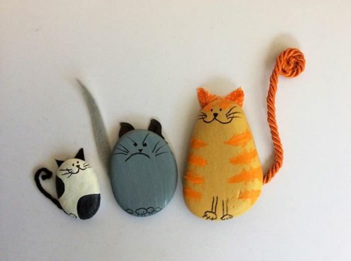 peinture sur galet, chatons sympathiques créés avec des galets
